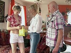 The guy was away and his girlfriend, a total hottie, had to deal with his parents who came around to visit. Well, look at her, is there any way she could have dressed skimpier? To make things worse, the guy's mom and dad came around with a gift for her. Yay, a set of lingerie! One has still to find out where trying the lingerie on evolved into a threesome. At some point definitely! Both the old man and his wife were horny to the point of no return, and they literally pushed their son's girlfriend between them into a sinful sexual sandwich. Ouch! The guy came and it was quite a bit of a disaste