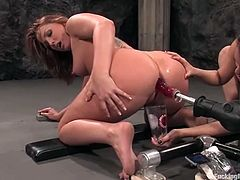 Annie Cruz and Flower Tucci take their clothes off in some basement. Then they get their hot pussies destroyed by the fucking machine.