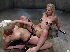 Sexy blonde girl stands on her knees and sucks the strap-on like it is a real dick. Later on she gets her tits wired and pussy toyed by Lorelei Lee.
