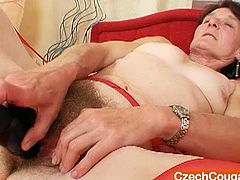 Czech milf is eager for orgasm and uses dildo fellow to satisfy her insatiable hairy pussy. She spreads her legs wide and thrust toy between worn out pussy curtains. Enjoy kinky momma for free!