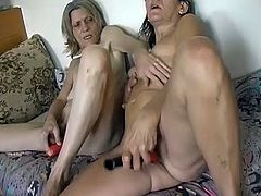 Dare to press the play button and watch how two ugly old bitches with saggy tits lick and fuck each other's dirty hairy snatches with dildo in pose number 69.