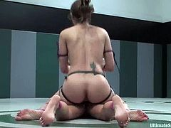Amber Rayne and Jennifer Dark are two sexy girls in bikini who fight in a ring. Jennifer loses this fight, so she has to lick Amer's pussy and ride a dildo.