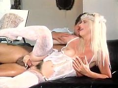 Lusty light haired Italian babe in sexy white lacy lingerie takes massive cock up her moist hairy snatch lying on her side from behind.