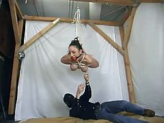 What a girl Jewell Marceau is! She gets naked and it makes her feel so good, when she gets hogtied and suspended high!