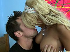Bodacious blonde hussy Briana Blair jiggles her big natural hooters in front of Johnny Castle. Dude carefully bites her nipples and squeezes Briana's big boobies.