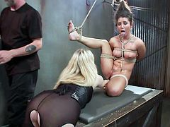 Serena loves it, when she's treated like the whore, she is. The sexy blonde Aiden and her friend, executor The P0pe, hanged this slut and now, they play with her. Serena hangs there in a very uncomfortable position, as they rub her cunt with a vibrator. Curious what else they will do to this slut?