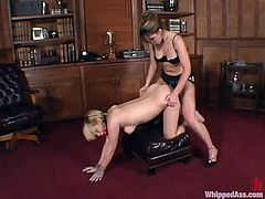 Isabella Soprano is having fun with Gia Paloma in the study. Isabella binds Gia and whips her ass with a lash before poking a strapon into her hot pussy.
