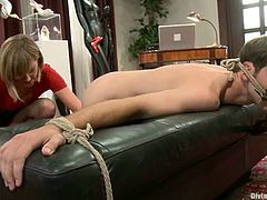 Nomad is playing BDSM games with salacious dominatrix Maitresse Madeline. The bitch binds the guy and plays with his ass and then pounds his brown cave with a big toy.