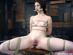 Busty brunette Faith Leon is having a good time with her dominant lesbian GF in a basement. Faith gets ties up and then enjoys current rushes going through her tits and cunt.