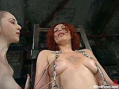 See how this redhead gets chained to a chair and how her pussy and nipples are tortured in different ways. It's all very kinky indeed.