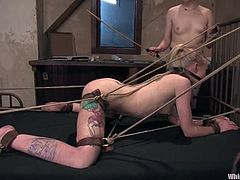 Slim and hot blonde girl gets punished by Claire Adams. She gets whipped and spanked painfully. Later on she also gets toyed from behind with a strap-on.