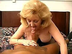 Salacious blonde mom Kitty Foxx shows her amazing cock-sucking skills to some guy. Then she moves her legs wide apart and gets her shaved cunt drilled in missionary position.
