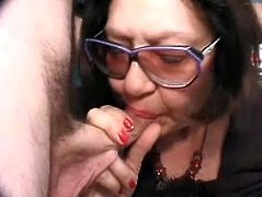 Big-breasted dark-haired granny Big Bertha is having fun with two men indoors. She sucks their dicks hungrily and then gets her old cunt pounded deep and hard.