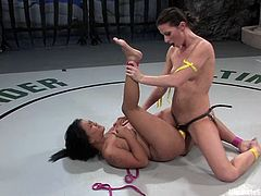 Ariel X and Leilani Li fight each other in a catfight. Surely, Ariel wins beacause she is much bigger. So, Asian girl gets her mouth and pussy stuffed with the strap-on.