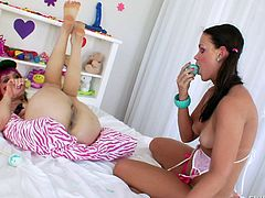These cuties are girlish and slutty in the same time. They fool around in their bedroom and have some very kinky anal! Paige stays with her legs up as her girl plays with her hot, tight anus. She spits & fingers it and then inserts a big dildo in her anus. After having so much fun, the bitch gives Paige a rimjob!