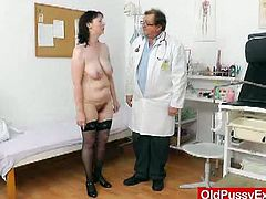 Blanka has her old, hairy pussy examined by her doctor. He needs to take a sample of her pussy juices, so he has to stretch her hole with a speculum to do so.
