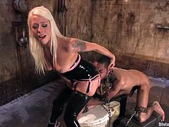 Lorelei Lee is having fun with black stud Mickey Mod. She binds the guy and fucks his butt with a strapon and then takes a great ride on his cock.