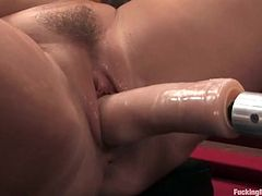 Big booty blonde chick sits on a billiard table toying herself with a dildo. After that she sits down on the floor and gets drilled by the fucking machine.