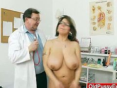 This MILF has some seriously big natural tits and it is insertion time as she hits the exam table. Her pussy gets wetter than it's been in a long time