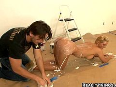 Sexy blonde milf Phoenix Marie is getting naughty with some guy indoors. They play with paint and then fuck in side-by-side and other positions on the floor.