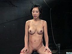 Asain hottie Tia Ling allows some guy to put her into chains and torment her in a basement. The dude rubs Tia's pussy with a toy and the cutie gets a strong orgasm.