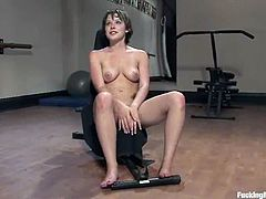 This chick decides to have some fun instead of work out. She strips her clothes in the gym and gets her pussy drilled by the fucking machine.