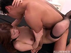Get a load of Yuuka Minas amazing breasts in this hardcore scene where she takes a ride on a hard cock while wearing stockings.