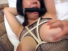 Tied asian girl gets her pussy dildoed in bdsm.