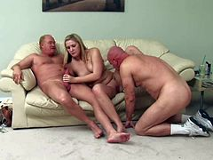 Shy pale amateur blonde with natural tits and average body gets naked for some cash and fucks with two mature dude on couch at the same time for some cash.