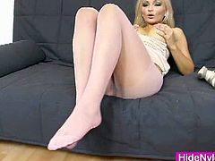 Nicky angel touches herself with her nylons on