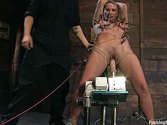 Amazingly hot blonde chick gets tied up with ropes and tortured with clothespins. Later on she gets her pussy toyed by a fucking machine.
