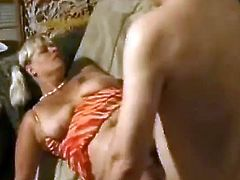 Horny blonde slut with big natural saggy tits giving head to this dude. First he licks her gaping cunt and then fucks her hard and noisy.