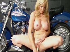 MILF Mia uses her dildo to make herself cum and squirt - all while she's hanging out on a motorcycle! She cums so much she slips and then cums again while squatting on the floor.