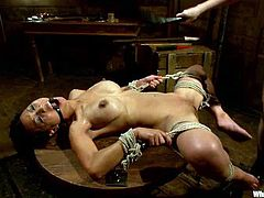 Tied up Asian chick licks Aiden's big boobs. After that Tia gets whipped and toyed rough from behind. She loves to be treated in this way.