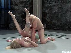 Alexa Von Tess and Sarah Jane Ceylon fight in a ring and the blonde loses. So, Alexa pulls Sarah's hair and toys her vagina with a strap-on.