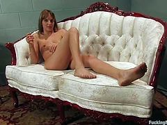 Nasty girl lies naked on a couch fingering and toying her wet pussy. After that she gets her tight ass drilled by the fucking machine.