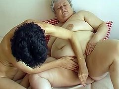 Tight brunette MILF with ugly face pokes fat pussy of hefty BBW granny with big dildo. You're going to puke all over the place if you press the play button.