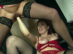 Gonzo fisting porn scene featuring two raunchy moms. They both are acting wild and naughty on set. Redhead one gets her cunt stretched wide with huge dildo. Her cunt is fisted bad later on. Damn wacky porn clip presented by Filthy and Fisting porn studio.