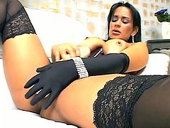 Hot Latina in stockings and a corset sucks massive dildo. Then she takes her panties off and starts to shove this dildo deep in her pussy.