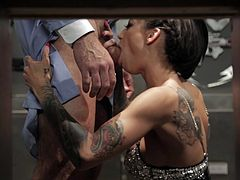 This forensic doctor is working on something when this brunette slut comes to distract him. She shows her tattooed boobs and as soon as his human flesh is strong she starts to give slow lick but eventually she speeds up. Then this guy holds her by her hair and pushes his dick in her deep from back.