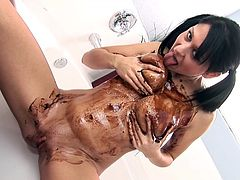 Damn, she's a beauty! this Hungarian babe has all she needs to make a man horny and because she's such a bad girl and wants to taunt us. Here she is naked and making a mess with her chocolate syrup. The brunette covers herself in it and rubs her pussy and ass hole like a cheap whore. Delicious!
