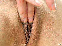 Small tits and shaved vagina is what makes that horny hoe look sexy while she rubs her cunt and put some sex toys deep inside of it.
