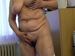 Plump pale skin grandma with huge tits gets naughty in kitchen. Old floozy lies on the floor totally naked and diddles her smelly hairy cunt with long cucumber.
