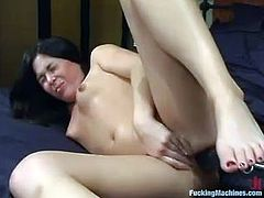 Nice brunette babe in school uniform fingers herself in a bedroom. Then she gets toyed in pussy and ass by the fucking machine. After that she gives a blowjob to Trent.