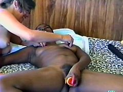 A slim ebony chick is playing lesbian games with her pretty GF. They lick and finger each other's nice pussies and then drill them with a dildo and moan with pleasure.