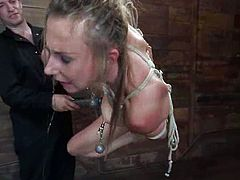 Sasha Lexing gets an orgasm while being dominated in a cellar