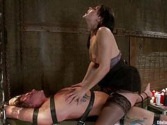 He is feeling some pain and despite that inconvenience, her slave keeps his cock hard for her. She just rides him like a crazy bitch!