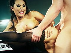 Passionate porn actress Asa Akira takes hard dong in her mouth demonstrating her stout blowjob skills. She then bends over the hood getting nailed deep from behind.