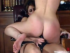 Lovely blonde babe gets her nice ass spanked. After that she also licks her mistress' pussy. Surely, then she gets her vagina drilled with a strap-on.