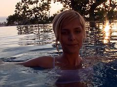This babe has swimming while her dude was recording her. She came to him and start giving nice blowjob until he cums in the pool.